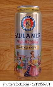 SARANSK, RUSSIA - OCTOBER 26, 2018: Can of Paulaner Hefe-Weibbier on wooden background.