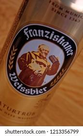SARANSK, RUSSIA - OCTOBER 26, 2018: Can of Franziskaner Weissbierbeer on wooden background.