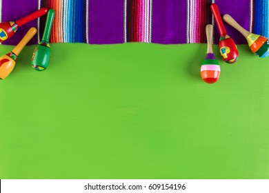 sarape blanket on a bright green background.