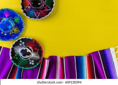 Sarape blanket on a bright yellow background.