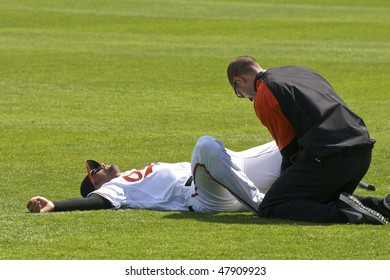 SARASOTA, FLORIDA - MARCH 3: Nick Markakis of the Baltimore Orioles warms up before the first Spring Training game of the year against the Tampa Bay Rays on March 3, 2010 in Sarasota, Florida.