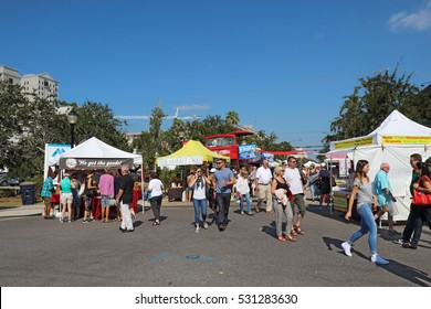 SARASOTA, FLORIDA -� NOVEMBER 19 2016: Vendors and shoppers at the Sarasota Farmers Market in fall. This vibrant event occurs downtown on Lemon Avenue and State Street every Saturday from 7 AM to 1 PM