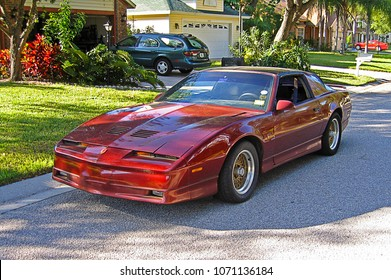 SARASOTA, FLORIDA/USA - OCTOBER 18, 2007: A Flame Red Metallic 1988 Pontiac Trans AM GTA parked in a residential neighborhood.