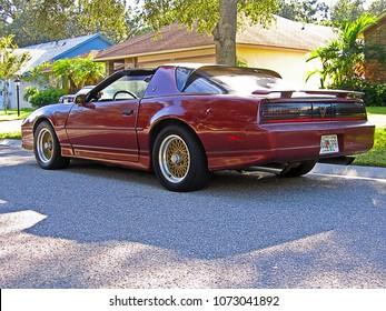 SARASOTA, FLORIDA/USA - OCTOBER 18, 2007: A Flame Red Metallic 1988 Pontiac Trans AM GTA parked in a residential neighborhood.