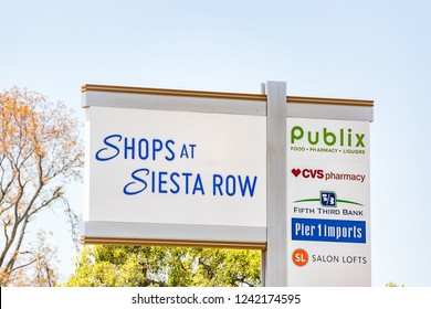Sarasota, USA - April 28, 2018: Florida city during day with closeup of Strip Mall sign called Shops at Siesta Row with Publix grocery supermarket, CVS