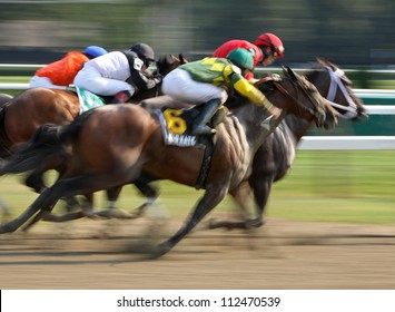 "SARATOGA SPRINGS - AUG 31: Jockey Jose Lezcano and ""Kid Katge"" surge down the outside to finish second in The Big Bambu Stakes at Saratoga Race Course on Aug 31, 2012 in Saratoga Springs, NY."