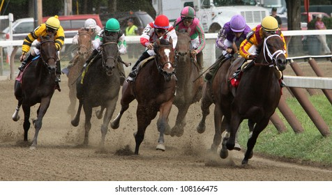 """SARATOGA SPRINGS - JUL 20: Jockey Rosie Napravnik and """"Kauai Katie"""" lead the field around the far turn enroute to the filly's first win on Jul 20, 2012 in Saratoga Springs, NY."""