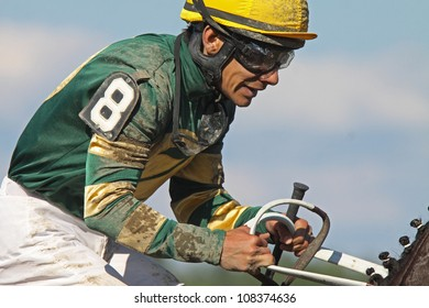 SARATOGA SPRINGS - JUL 21: Jockey Junior Alvarado reins in his mount after competing in an allowance race at Saratoga Race Course on Jul 21, 2012 in Saratoga Springs, NY.