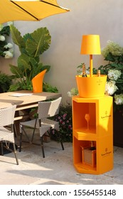 Saratoga Springs, New York - Summer, 2018: Outdoor seating area in new Sushi Bar, where bottles of Veuve Clicquot Champagne are presented to diners at The Adelphi Hotel,