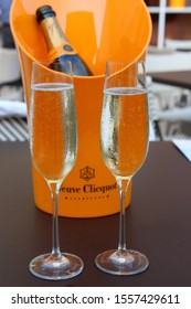 Saratoga Springs, New York - Summer, 2018: Large yellow ice bucket with Veuve Clicquot Champagne bottle serving two guests at new sushi bar in outdoor garden, The Adelphi Hotel.