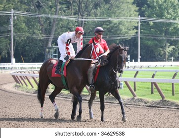 SARATOGA SPRINGS, NY- AUGUST 1:  Calvin Borel (L) aboard Go Swiftly in the post parade for the 7th race at Saratoga Race Track August 1, 2009 in Saratoga Springs, NY.