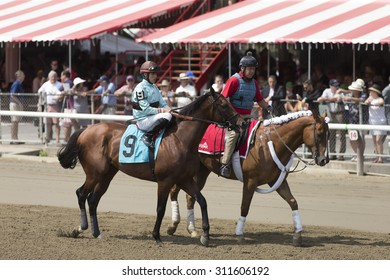 SARATOGA SPRINGS, NY - August 29, 2015: #9 Eternal Bird with I Ortiz, Jr. in  post parade for 4th race on Travers Day at Historic Saratoga Race Course on August 29, 2015 Saratoga Springs, New York