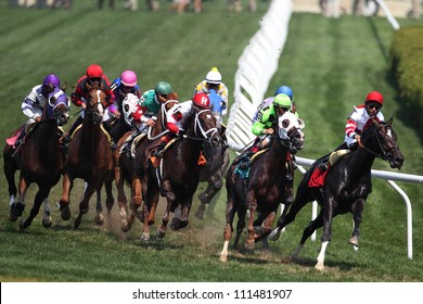 Saratoga Springs NY - AUGUST 4: Jockey Jose lezcano aboard The Thinker lead in the clubhouse turn on the way to winning the 4th race on August 4, 2012 Saratoga Springs, New York