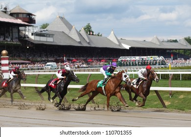 SARATOGA SPRINGS, NY - JULY 27: The field moves through the clubhouse turn in the third race on July 27, 2012 at Saratoga Springs, New York