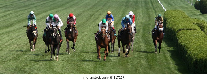 SARATOGA SPRINGS, NY -SEPT 3: Rajiv Maragh (green cap, center) guides Sugar Again to victory in the Paris Opera Stakes at Saratoga Race Course on Sept 3, 2011 in Saratoga Springs, NY.