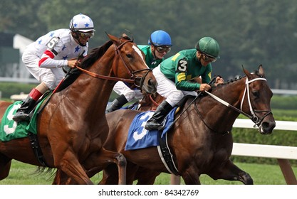 """SARATOGA SPRINGS, NY - SEPT 4: """"Dust and Diamonds"""" (Javier Castellano up) edges out """"Fantasy of Flight"""" to win an allowance race at Saratoga Race Course on Sept 4, 2011 in Saratoga Springs, NY."""