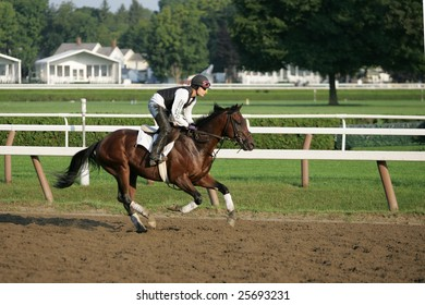 SARATOGA SPRINGS - September 2: An Unknown Rider Works a Horse in the Morning on the Saratoga Main Track on September 2, 2005 in Saratoga Springs, NY.