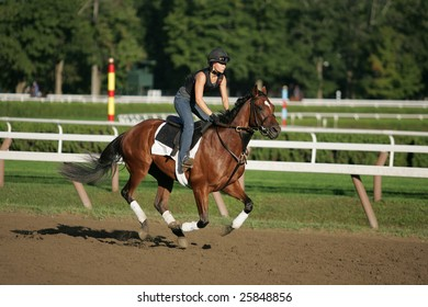 SARATOGA SPRINGS - September 4: An Unknown Rider Works a Horse in the Morning on the Saratoga Main Track on September 4, 2005 in Saratoga Springs, NY.