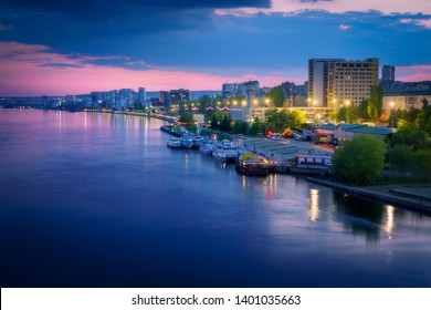 Saratov city skyline at sunset, panoramic view to quay from the bridge on Volga river. Russia