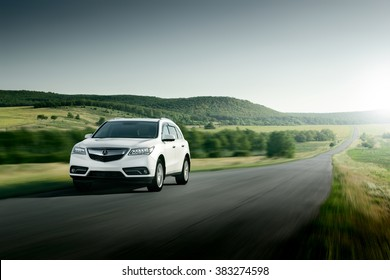 Saratov, Russia - August 11, 2015: Modern car Acura MDX fast drive on asphalt road at sunset