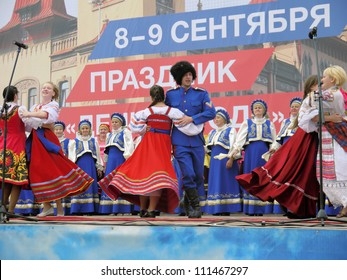SARATOV, RUSSIA - AUGUST 11: Local Cossack ensemble performs at the fair in the city of Saratov in August 11  2012.  Fair takes place at the Theater Square in Saratov.