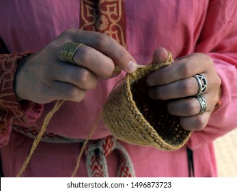 """SARATOV, RUSSIA - AUGUST 17, 2019: Festival of craftsmen and artists """"Craft Palette"""". A woman shows an ancient technique of knitting with a bone needle"""