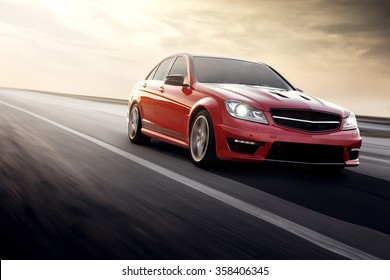 Saratov, Russia - August 24, 2014: Red sportcar Mercedes-Benz C63 AMG fast speed driving on the asphalt road at daytime