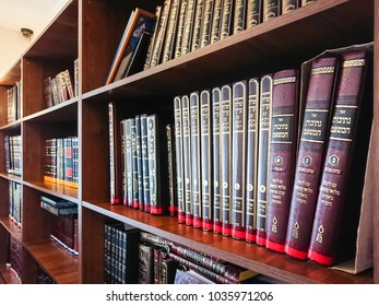 Saratov / Russia - February 25, 2018: Library in the synagogue. Multi-colored books on the bookshelf in the library