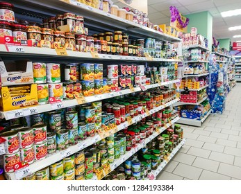 Saratov / Russia - January 2, 2019: Goods on the shelf of a grocery store. Canned vegetables and fruit.