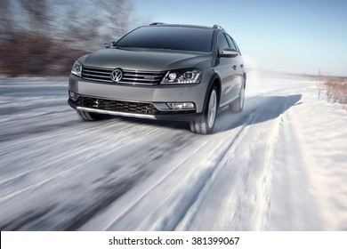 Saratov, Russia - January 26, 2014: Gray modern car Volkswagen Passat Alltrack drive speed on road at winter daytime