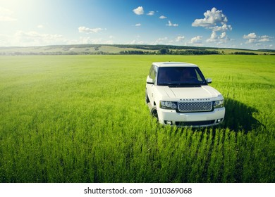 Saratov, Russia - July 12, 2017: Car Land Rover Range Rover is standing at green grass meadow at summer day