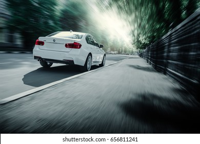 Saratov, Russia - May 07, 2017: White BMW 3 Series F30 car is driving on asphalt road at summer daytime