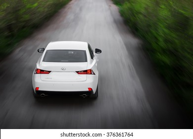 Saratov, Russia - May 8, 2014: White modern car LEXUS IS F SPORT fast speed drive on asphalt road.