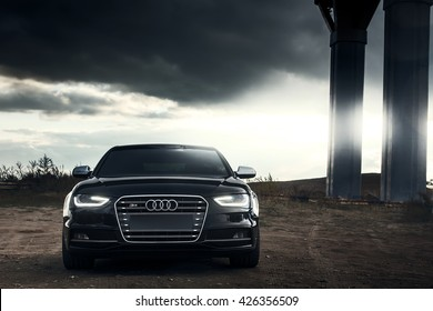 Saratov, Russia - October 01, 2014: Black AUDI S4 car at parked on countryside road at sunset