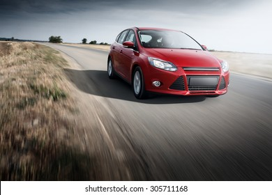 Saratov, Russia - September 21, 2014: Red car Ford Focus III Sport fast speed driving on the apshalt road at daytime
