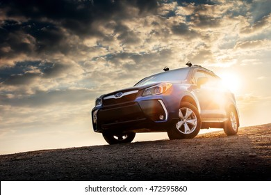 Saratov, Russia - September 23, 2014: Car Subaru Forester stand on countryside road at sunset