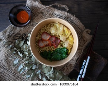 Sarawak Kolo Mee Flatlay. Wanton Noodles on Wooden Table with Copy Space. Asian Noodles with Chili Sauce. - Shutterstock ID 1800075184