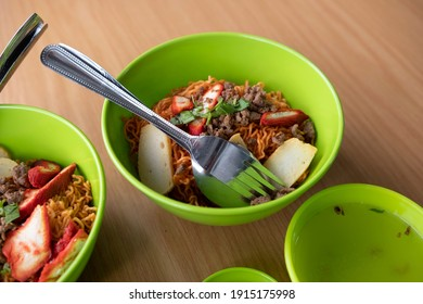 Sarawak Kolo Mee. Wanton Noodles on Wooden Table. Asian Noodles with chili sauce, minced meat, chicken meat and vegetable  - Shutterstock ID 1915175998