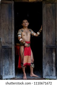 SARAWAK, MALAYSIA, APRIL 1, 2018 - The Head of Longhouse of Iban dressed with the traditional dress in Sarawak Cultural Village.