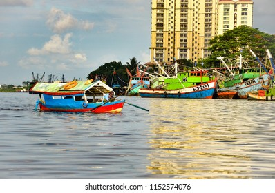 Sarawak, Malaysia. July 10, 2013. Shot local boat operator in Kuching, Sarawak. Boat, also known as sampan by local, is one of the important transportation especially in rural area.