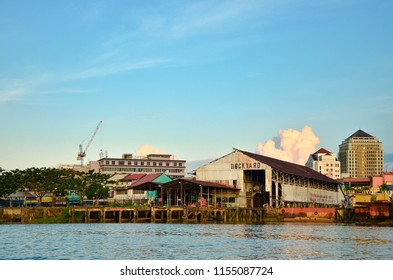 Sarawak, Malaysia. July 10, 2013. Shot of conventional dockyard along side of the river in Sarawak. Common scene for small business entity and local fisherman using the dockyard.