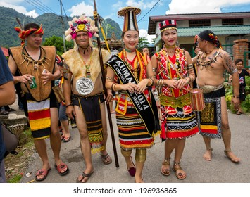 SARAWAK, MALAYSIA: JUNE 1, 2014: People of the Bidayuh tribe, an indigenous native people of Borneo, in traditional costumes, take part in a street parade to celebrate the Gawai Dayak festival.