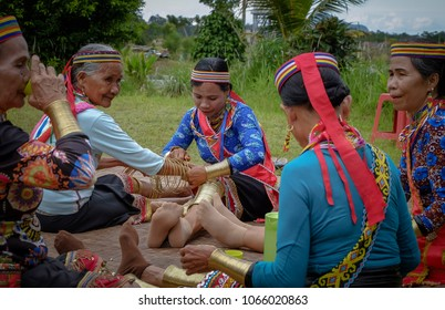 SARAWAK, MALAYSIA: MAC 30, 2018 - Anik Unggom (3R) has wear a copper ring on women hand, four women from Bidayuh Biatah who still wear it and believe in luck and beauty to the wearer.