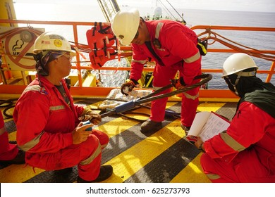 SARAWAK, MALAYSIA - MARCH 30th, 2017: Rigger Team and Safety Officer doing lifting gears inspection used for rigging and slinging activities.