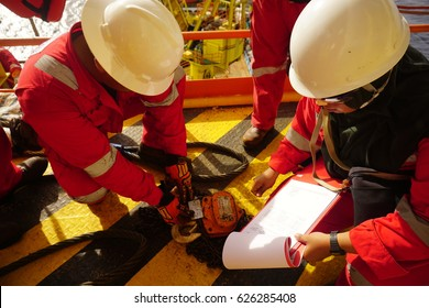 SARAWAK, MALAYSIA - MARCH 30th, 2017: Lifting gear inspection by Rigger Team and Safety Officer, which is chain block used for rigging and slinging activities.