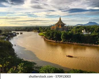 Sarawak River under the evening sun in Kuching, Sarawak - Shutterstock ID 570913003