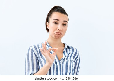 Sarcasm emotion Brunette girl  portrait against white background