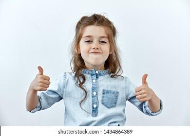 Sarcasm emotion. Little girl portrait against white background