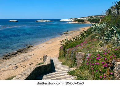 S'Archittu is a small coastal town near Oristano on the west coast of Sardinia, Italy. The town takes its name from the nearby natural arch (S'Archittu or little arch).