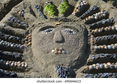 sarcophagus made by children on the beach  with sand and shells